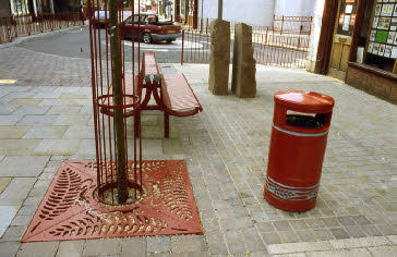 The artwork and street furniture combine to create a distinctive and imaginative streetscape.