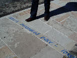 Each poetry band in the paving was designed to refer to the adjacent shop