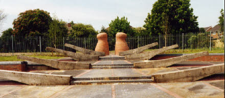 'Old Cut, New Rise' Wednesfield, Wolverhampton – seating inspired by canal lock gates, rising to giant mooring bollards