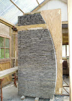 Gateway sculptures in Welsh slate continue the barrel theme.