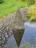 A reflected image completes the symmetry of the pyramid