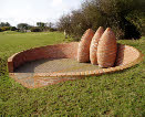 The grain-shaped sculptures at Tyddyn Mon Farm on Anglesey create a viewpoint across the island.